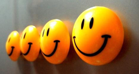 Smiley content pour l'économie du bonheur